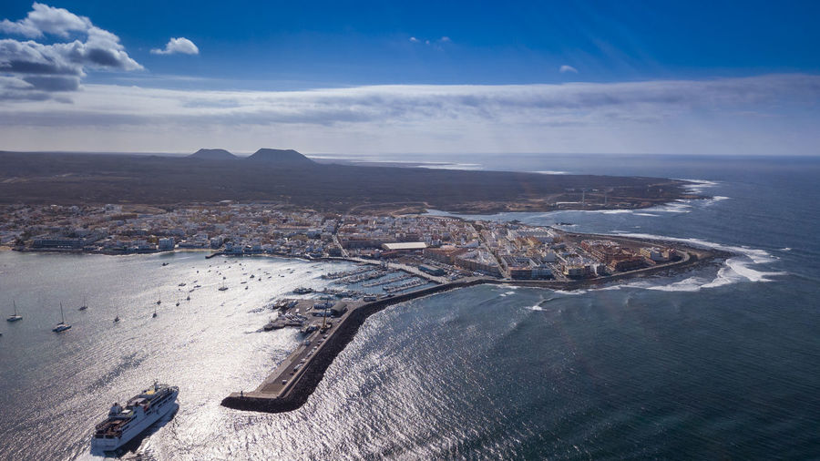 aerial view of corralejo fuerteventura Aerial View Architecture Beauty In Nature Building Exterior Built Structure City Cloud - Sky Day Environment High Angle View Nature No People Outdoors Scenics - Nature Sea Sky Tranquil Scene Tranquility Transportation Water