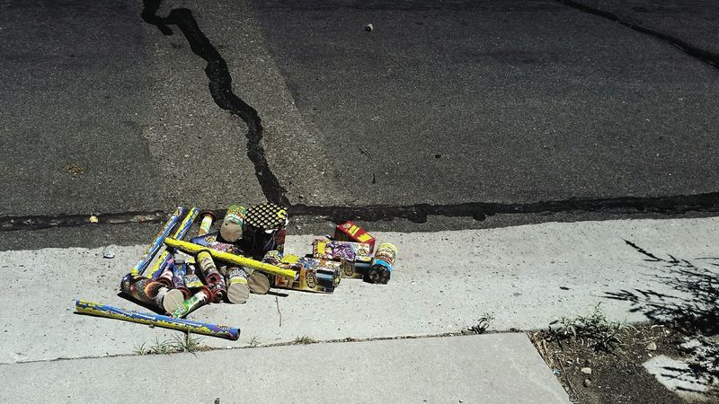 Fireworks in the gutter. 4th Of July 5th Of July Gutter Curb Garbage Used Spent Fireworks Street Asphalt Explosive Exploded  Hangover Trash The Day After The Next Day Next Morning Morning After Holiday