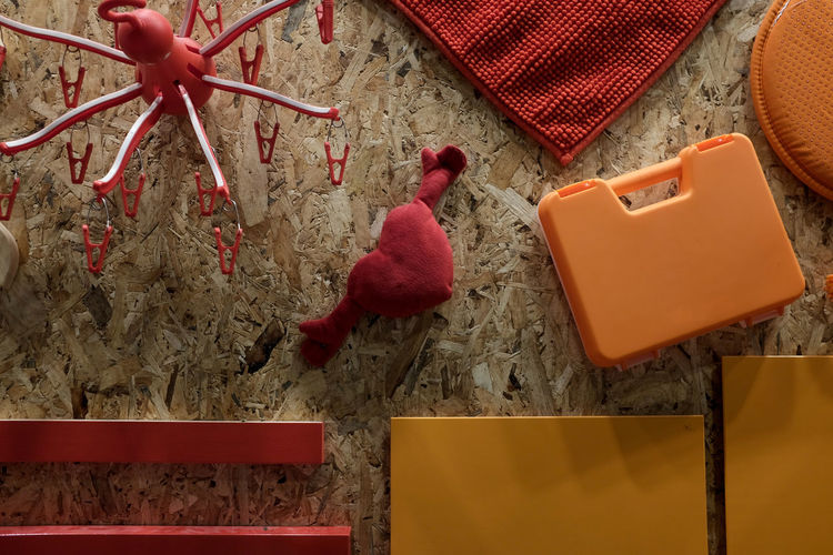 Background texture made of household items in theme of red and orange. IKEA Orange Red Background Textures Close-up Compress Wood High Angle View Household Items Household Objects Indoors  Representation Sellective Focus Still Life