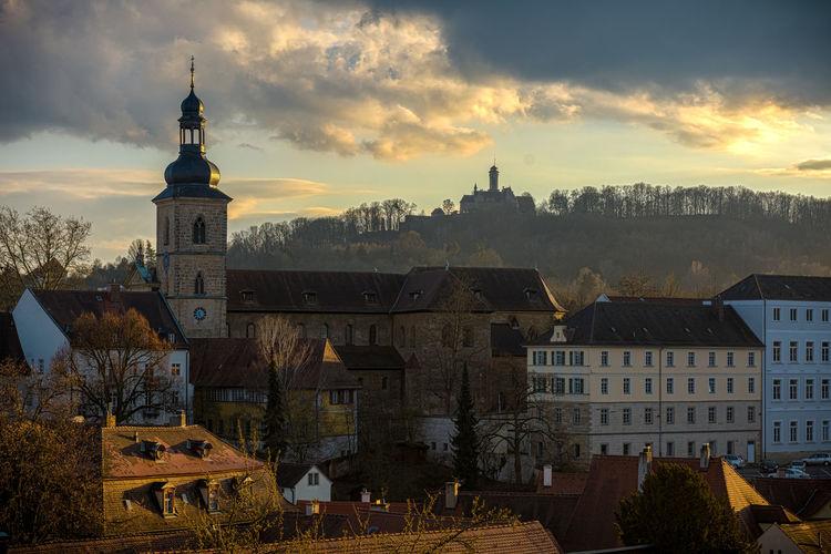 Michaelsberg abbey in town against sky