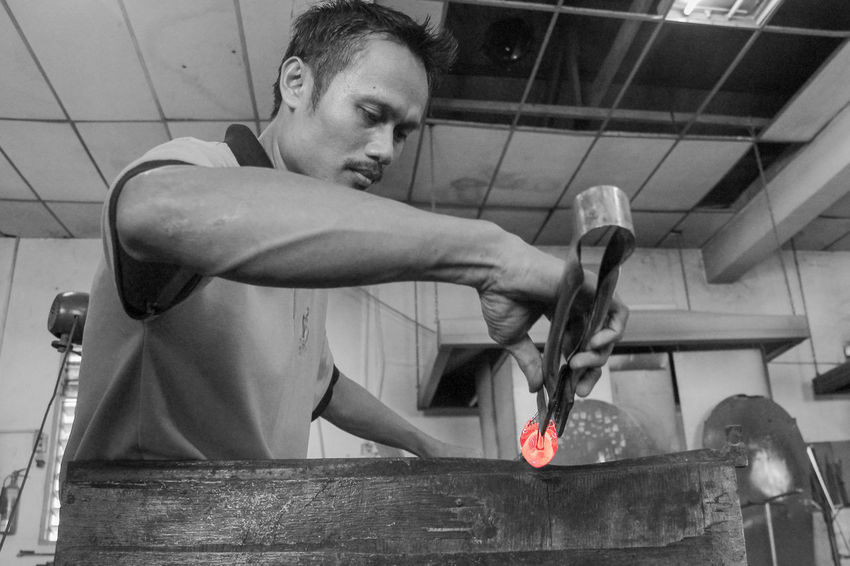Follow your passion, be prepared to work hard and sacrifice, and, above all, don't let anyone limit your dreams. Black & White Blackandwhite Glass Glass - Material Glass Art Hard Work Holding Indoors  Jobs Life Lifestyle People Person Sitting Street Streetphotography Work Working Working Hard
