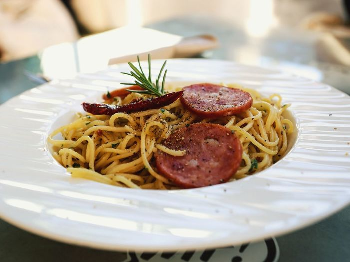 Close-Up Of Prepared Food Of Noodles With Salami