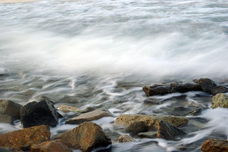 Turbulence seawater and rock at coastline