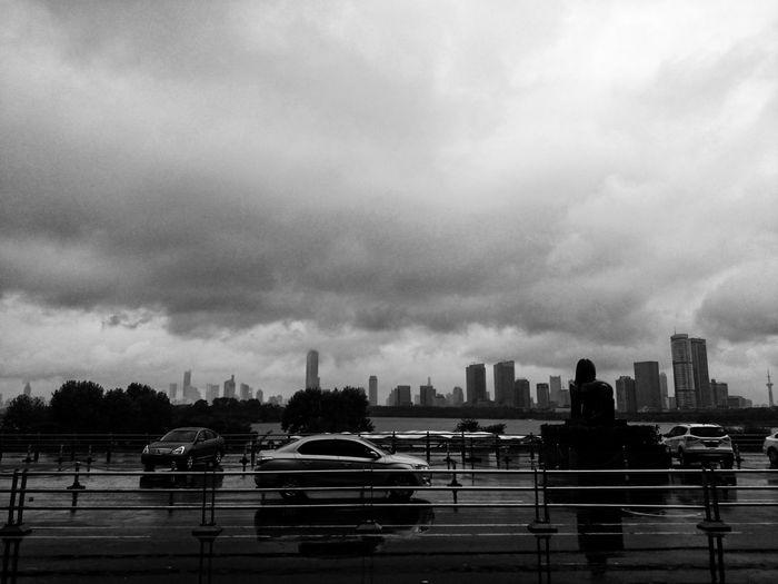 Cars on city against sky