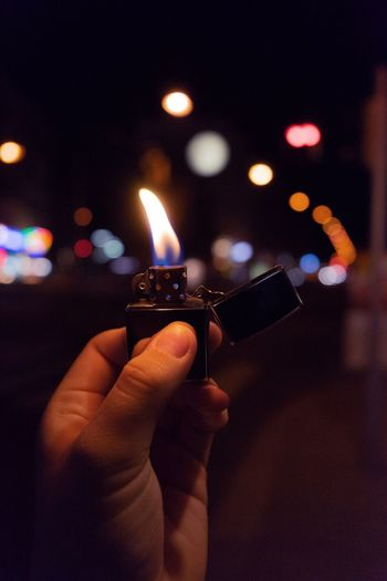 Close-up of hand igniting cigarette lighter
