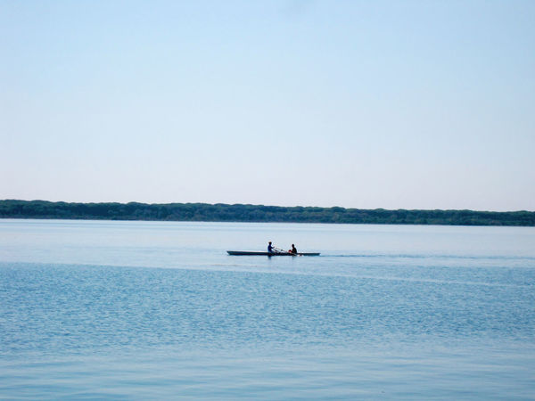 Laguna di Orbetello Adult Beauty In Nature Blue Clear Sky Day Horizon Over Water Men Nature Nautical Vessel Oar Outdoors Paddleboarding People Real People Rowing Sailing Scenics Sea Sitting Sky Transportation Two People Water Waterfront