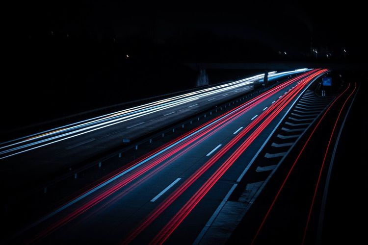 Motorway at night Illuminated Night Transportation Light Trail Long Exposure Motion Speed Road Blurred Motion Tail Light Traffic Red Highway No People