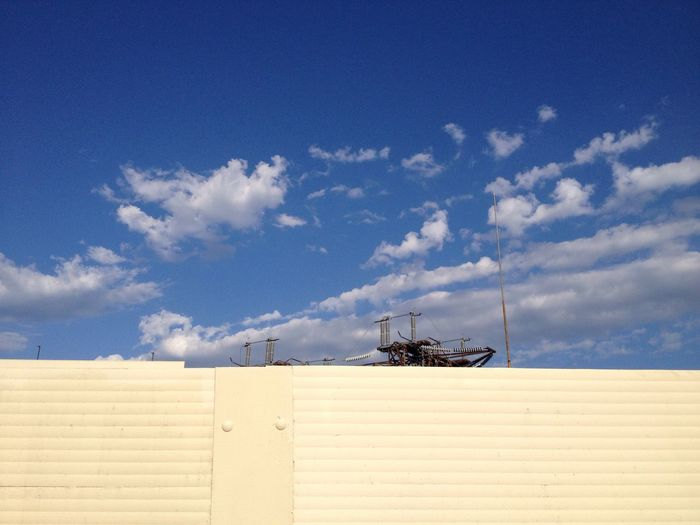 Fence at construction site against sky