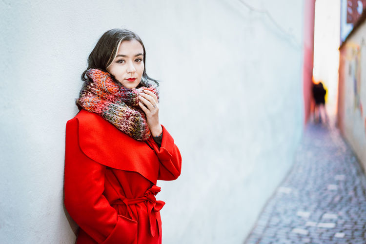 City Street One Person One Woman Only Portrait Of A Woman Looking At Camera Wall - Building Feature Scarf Wool Warm Clothing Young Women Portrait Beautiful Woman Cold Temperature Women Winter Beautiful People Red Standing Red Lipstick Lipstick Make-up Eye Make-up The Modern Professional