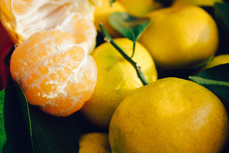 tangerines with branches Food And Drink Food Healthy Eating Fruit Freshness Wellbeing Close-up Citrus Fruit No People Orange Color Still Life Group Of Objects Indoors  Focus On Foreground Orange Orange - Fruit Day Lemon Yellow Tangerine Ripe