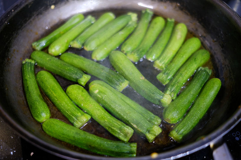 Courgettes in a pan. Courgettes Freshness Vegetarian Vegetarian Food Zucchini Close-up Courgette Day Food Food And Drink Fresh Freshness Green Color Healthy Eating Indoors  No People Pan Vegan Vegetable Vegetables Water