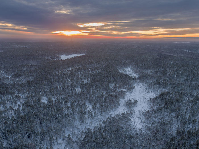 Winter Wintertime Aerial View Beauty In Nature Cloud - Sky Cold Temperature Day Dramatic Sky Forest Freshness Landscape Nature No People Outdoors Scenics Sea Sky Snow Sunset Tranquil Scene Tranquility Travel Destinations Water Wilderness