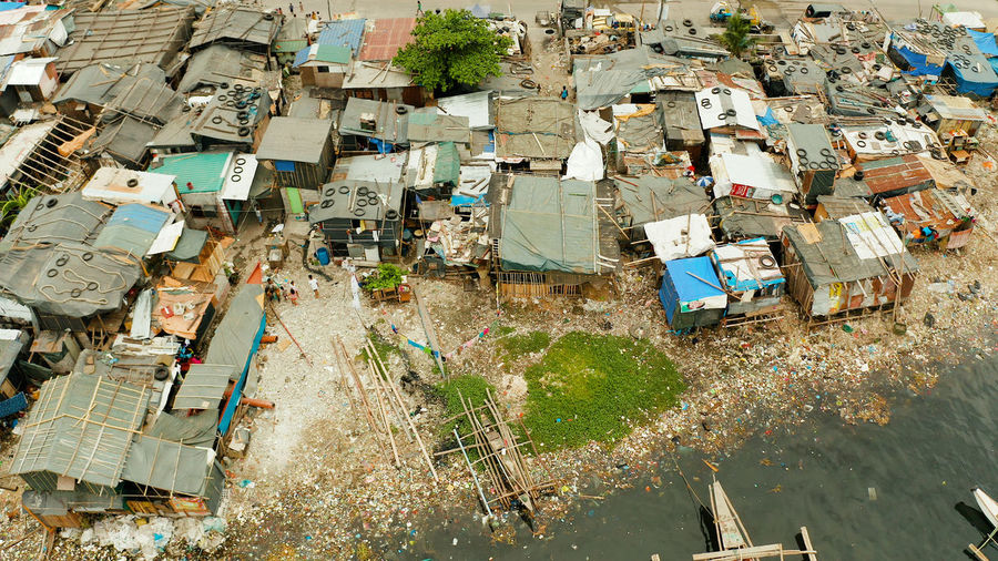 High angle view of garbage amidst buildings in city