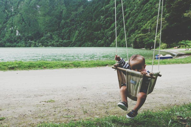 Rear view of boy on swing