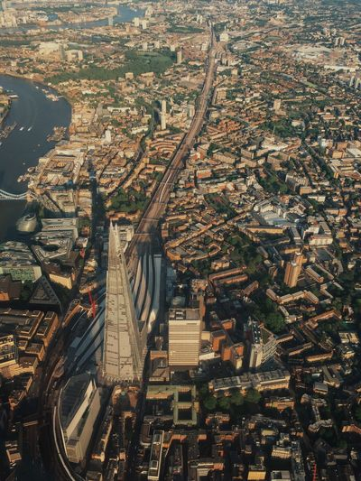 Aerial view of shard london bridge amidst buildings in city on sunny day