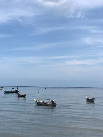 Nautical Vessel Transportation Mode Of Transportation Water Sea Sky Scenics - Nature Outdoors Tranquil Scene Moored Horizon Over Water Horizon Incidental People Waterfront Nature Day Beauty In Nature Cloud - Sky Travel Tranquility