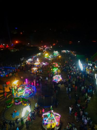 The Fair Crowd Crowded Light Lightning Fun Fair Fun Fair Ride Top Perspective Airportphotography People Tradition Gathering Entertainment Event Yearly Event City Crowd Cityscape Illuminated Multi Colored Celebration Sky