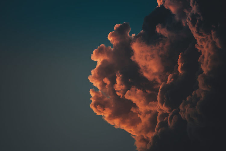 Low angle view of cloud against sky at sunset