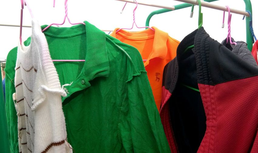 Close-up of clothes drying on rack