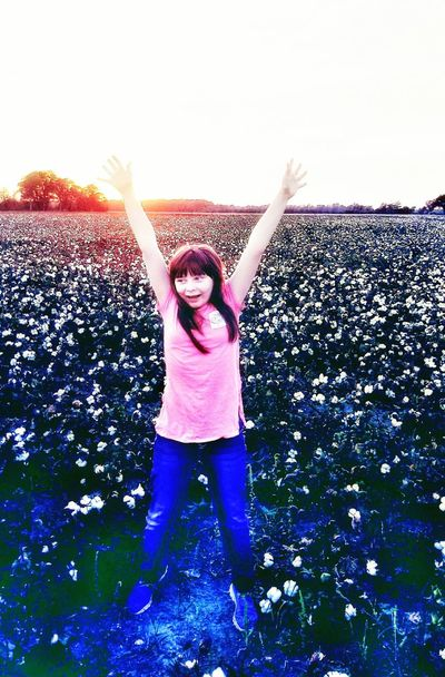 Spraying Motion Fun Young Adult Happiness Young Women Outdoors Cheerful People Day One Young Woman Only Smiling One Person One Woman Only Only Women Adult Adults Only Sky cotton field