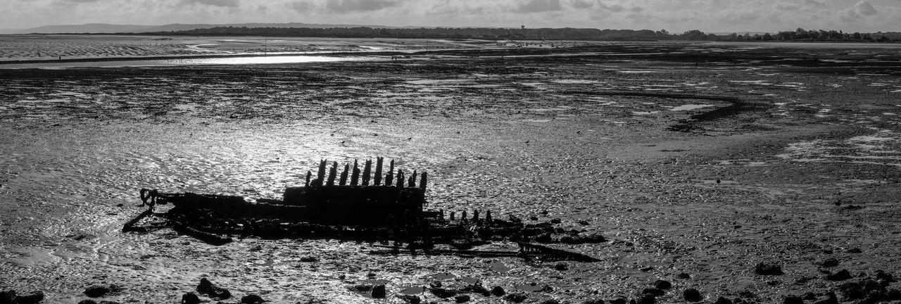 Black And White Boat Coastline Dirty Horizon Over Water Mud Ruined Slick Water Normandie 2015