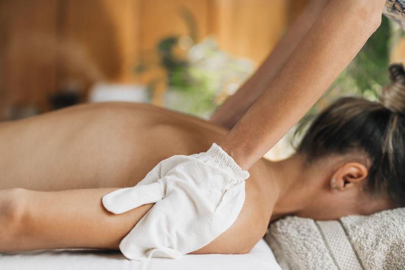 Ayurveda garshana massage, dry massaging technique with raw silk garshana gloves