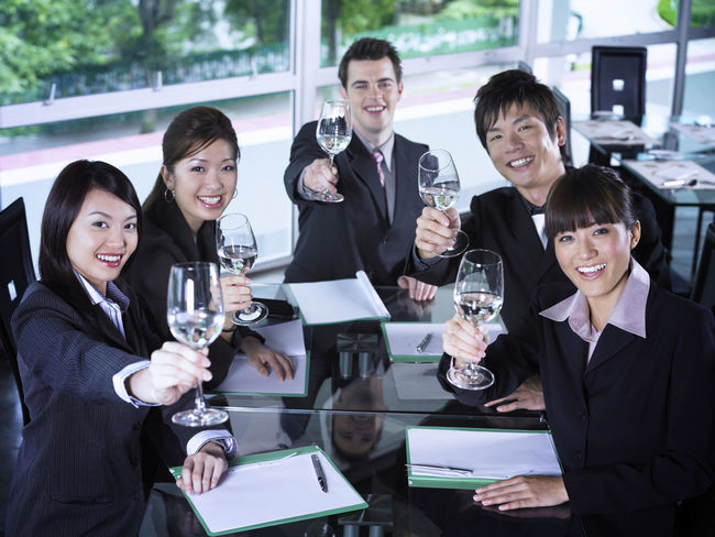 group of business people at restaurant Business Celebration Collaboration Food And Drink Full Suit Happiness Lunch Refreshment Toasting Well-dressed Wine Glass Businessman Businesswomen Champagne Cheers Colleague Formalwear Front View Group Of People Hotel Looking At Camera Lunch Meeting Restaurant Success Wine