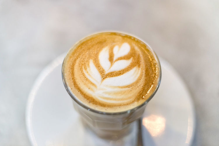 Coffee latte art Coffee Coffee - Drink Drink Refreshment Cappuccino Food And Drink Latte Hot Drink Frothy Drink Coffee Cup Mug Cup Froth Art Close-up Still Life Cafe No People Saucer Indoors  Focus On Foreground Crockery Caffeine Coffee Shop