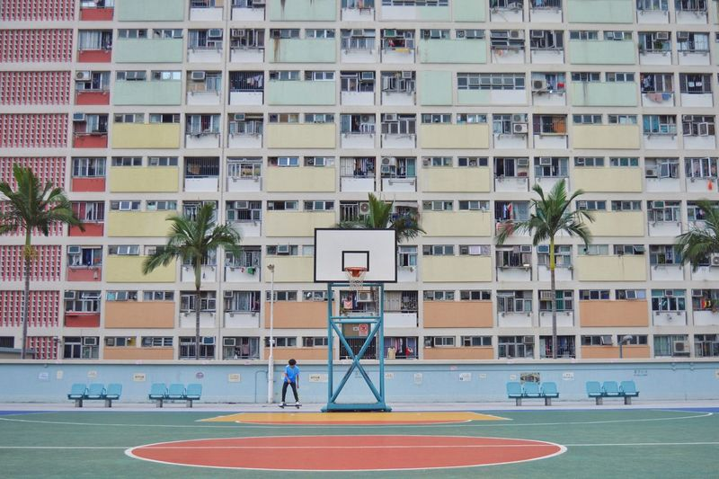 Basketball Hoop Against Residential Building
