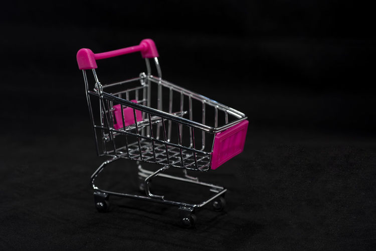Indoors  No People Shopping Cart Shopping Consumerism Metal Retail  Empty Absence Close-up Pink Color Basket Store Still Life Trolley Bag Side View Push Cart Single Object Studio Shot Purple