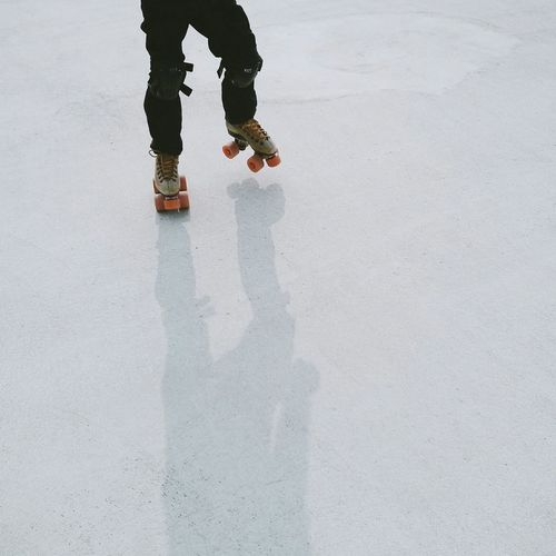 Low section of person roller skating
