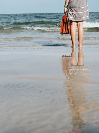 Woman standing on the beach with vintage suitcase,travel concept. Travel Vintage Luggage Ankle Deep In Water Beach Beauty In Nature Day Horizon Over Water Human Body Part Human Leg Lifestyles Low Section Nature One Person Outdoors People Real People Sea Sky Standing Walking Water Wave