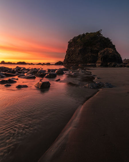 Sunset near Camel Rock, Trinidad, California Sunset Beauty In Nature Sky Rock Scenics - Nature Solid Rock - Object Tranquility Water Tranquil Scene Sea No People Land Nature Beach Idyllic Rock Formation Trinidad California Sunset_collection Landscape Landscape_Collection Cloud - Sky Pacific Sandy Beach