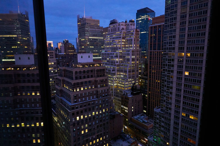 Aerial view of illuminated buildings at night in new york city