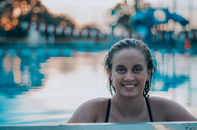 Portrait of smiling woman in swimming pool