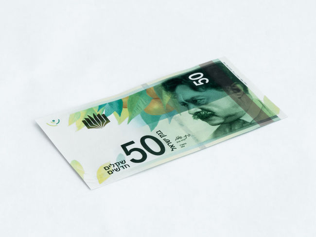 A new type of banknote worth 50 Israeli shekels isolated on a white background Wealth Banknotes Business Currency Economy Foreign Rich Bank Banknote Cash Close-up Commerce Credit Debt Economic Finance Investment Israel Money Paper Pay Profit Saving Shekel White Background