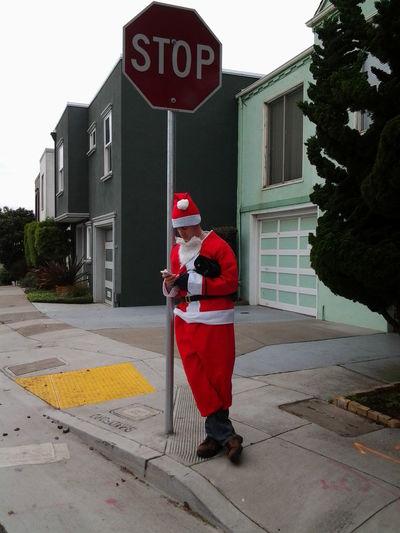 Hung Over Santa Leaning Santa Claus Red Santa Sand Santa Santa At A Bus Stop Stop Sign Techie Santa