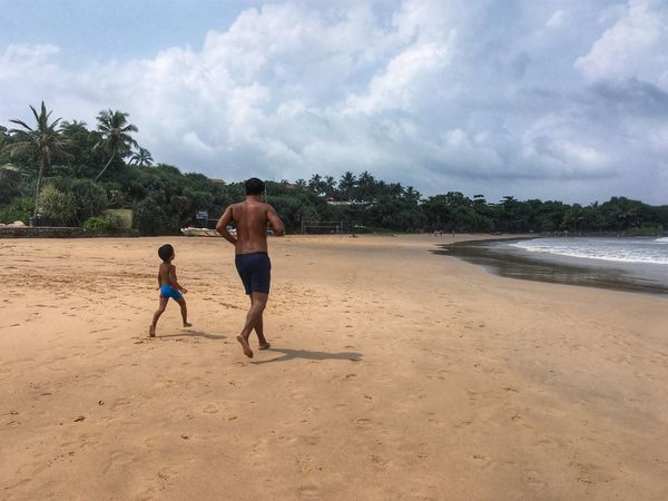 Followme ❤ Travel Destinations ASIA Travelling SriLanka Scenics Day Vacations Outdoors Leisure Activity Beach Sky Sand Cloud - Sky Two People Childhood Real People Running Fatherhood Moments Father & Son Bentota