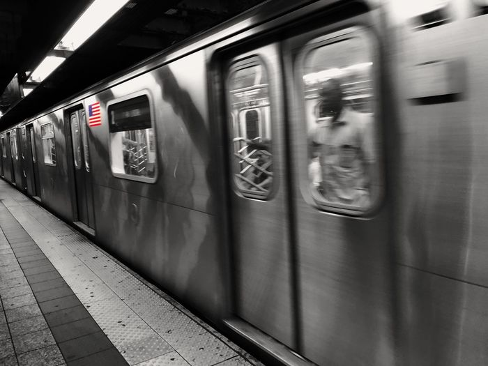 Urbanlife Colorkey Starsandstrips InMotion IPhoneography Blackandwhite Metro New York Transportation Mode Of Transportation Public Transportation Rail Transportation Train Train - Vehicle Subway Train Railroad Station Railroad Station Platform Passenger Train Travel Indoors  Motion
