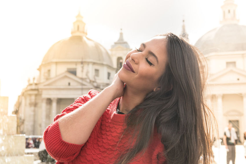 Young beautiful latina woman portrait with lens sun flare Relaxing Architecture Beautiful Woman Building Exterior Church Dome City Focus On Foreground Hairstyle Latina Women Lifestyles Long Hair One Person Outdoors Piazza Del Popolo Portrait Real People Smiling Sun Flare Tourism Travel Travel Destinations Women Young Adult Young Women