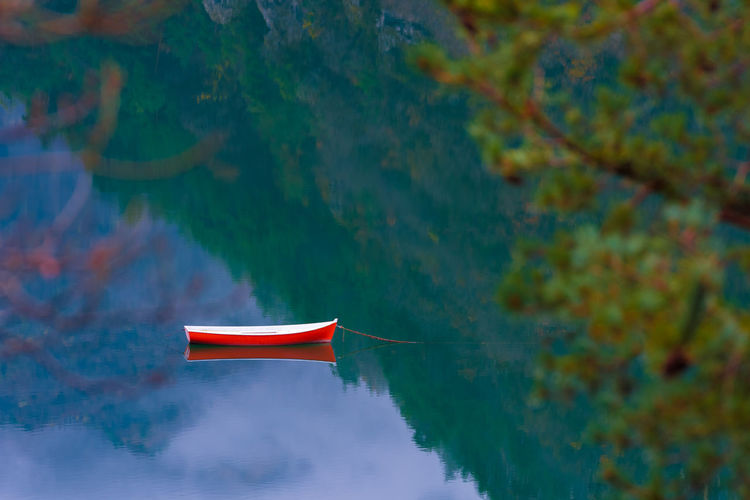 The red and white boat in the Valvestino lake, at the Alto Garda Bresciano park. Water Nature Cold Autumn Fall Italy Alps Italian Mountain Europe Alto Garda Garda Boat Outdoors Tranquil Scene Tranquility Beauty In Nature Lake Still Reflection Simplicity Empty Mode Of Transportation Rowboat Valvestino