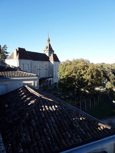 High angle view of trees and building against clear sky