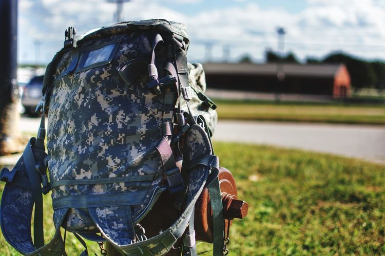 Close-up of army bag on field