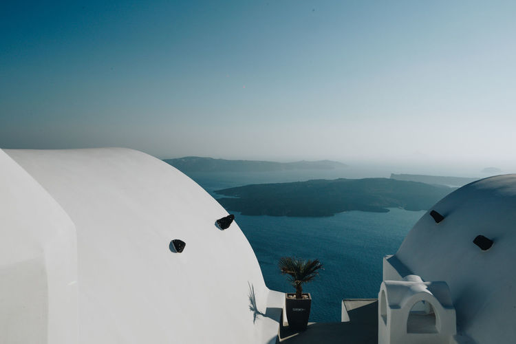 Scenic view of volcano against sky in santorini