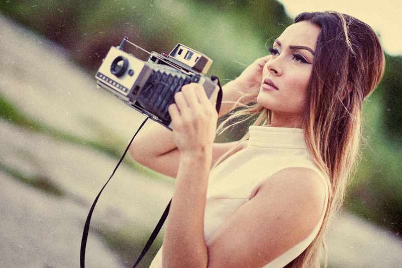 april 60s Fashion Camera - Photographic Equipment Casual Clothing Fashion Glamour Holding Lifestyles Old Outdoors Photographing Photography Themes Vintage Photo