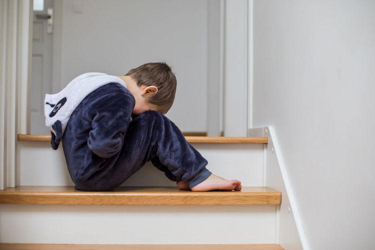 Boy sitting at home