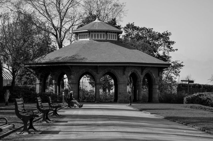 Arches Architecture Benches Black & White Black And White Building Exterior Built Structure Light And Shadow Man Sitting On A Bench Monochrome Outdoors Park Sitting On A Bench In The Park The Wayfor