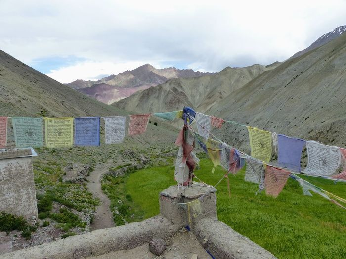 Clothes drying on mountain against sky