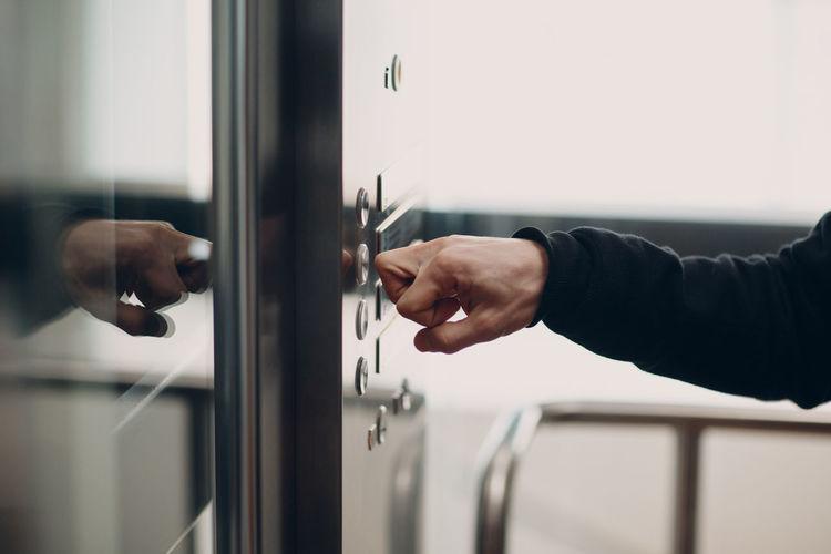 Close-up of man hand on door