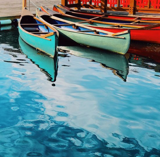 Boats moored in swimming pool